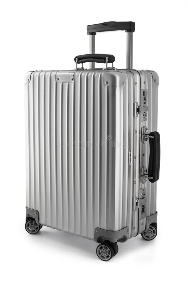 Suitcase or traveling luggage bag isolated on black background. Varna, Bulgaria - May 19 2018 - Rimowa traveling luggage bag or business suitcase studio isolated royalty free stock images
