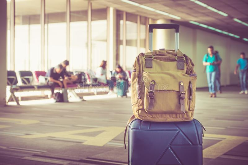 Suitcases and backpack in airport departure terminal with travel royalty free stock photos