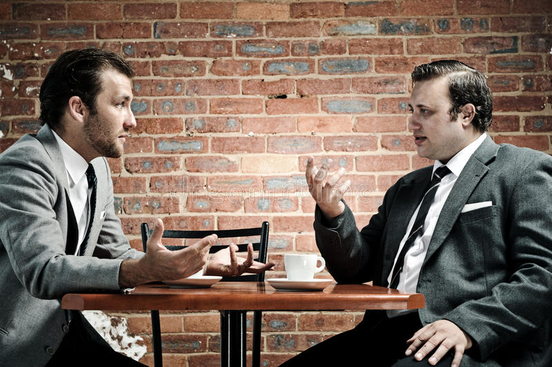 Suits, coffee and conversation royalty free stock images