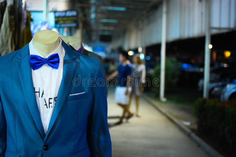 Suits show with puppets in store. royalty free stock photos