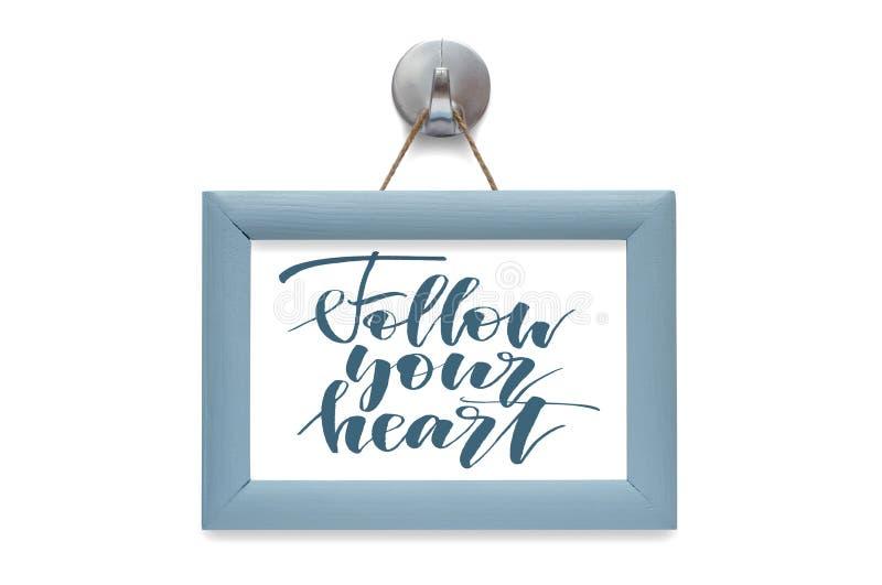 Suivez votre coeur - citation de motivation Lettrage stylis? bleu photos stock