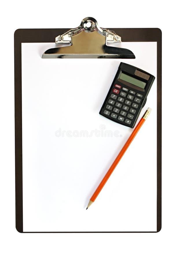 Sujetapapeles con la calculadora y el lápiz fotografía de archivo