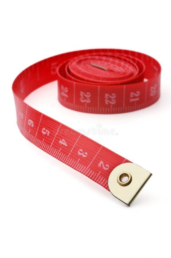 Sujetar con cinta adhesiva-línea roja fotografía de archivo libre de regalías