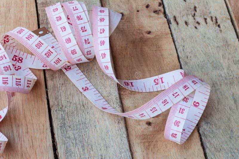 Sujete con cinta adhesiva la medición fotografía de archivo
