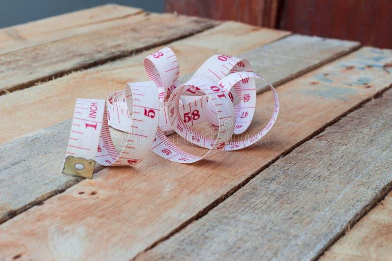 Sujete con cinta adhesiva la medición imagen de archivo