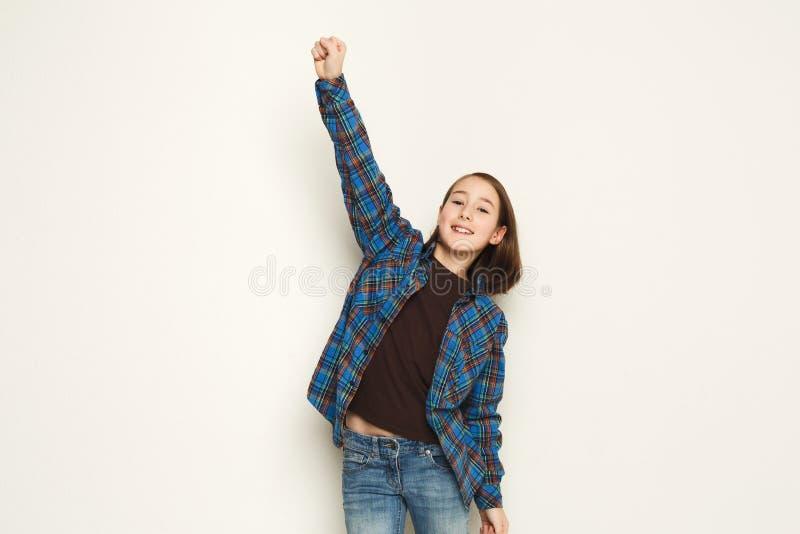 Sukces, szczęśliwa dziewczyna szeroko rozpościerać rękę na bielu fotografia royalty free