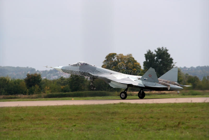 Sukhoi MAKS-2013 jet. Sukhoi MAKS-2013 fighter jet on runway at airshow royalty free stock photos