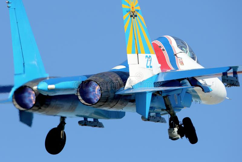 Sukhoi Su-27UB 22 BLUE of russian knights aerobatics team taking off at Kubinka air force base. royalty free stock images