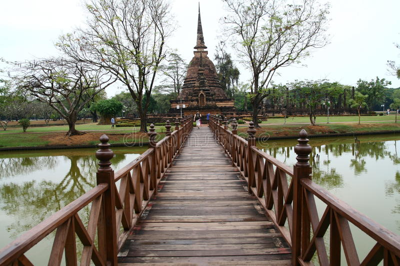 Sukhothai. Bridge toward stupa construction royalty free stock photo