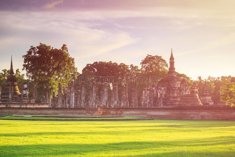 Sukhothai Historical Park at Sunset time, Sukhothai province, Lo. Cated in a beautiful setting of lawns, lakes and trees in north-central of Thailand stock photo