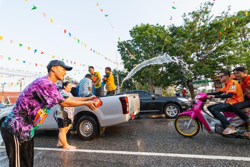 Sukhothai, Thailand - 14 April 2019: Thai people celebrating New Year Songkran Water Festival on the street.  royalty free stock photography