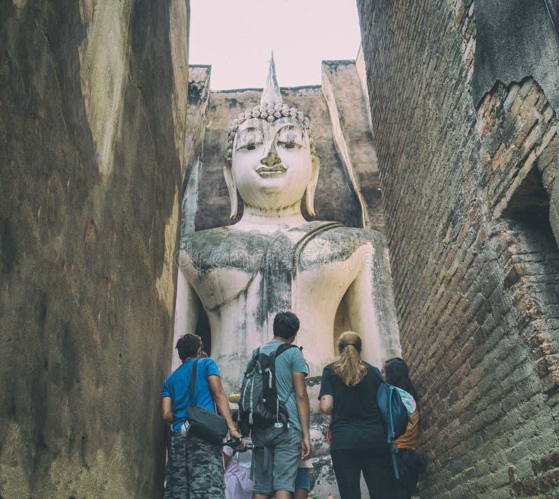 Sukhothai, Thailand - 23 October, 2018 Tourist group at Sri chum Temple historical park ,Inside sanctuary has a beautiful Big Budd royalty free stock photography