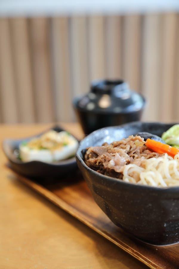 Sukiyaki donburi , sukiyaki hot pot stew with Japanese rice in bowl Japanese food. Sukiyaki donburi in closeup , sukiyaki hot pot stew with Japanese rice in bowl stock photos