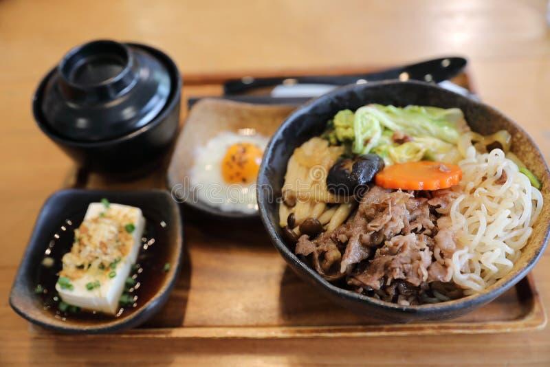 Sukiyaki donburi , sukiyaki hot pot stew with Japanese rice in bowl Japanese food. Sukiyaki donburi in closeup , sukiyaki hot pot stew with Japanese rice in bowl stock photography