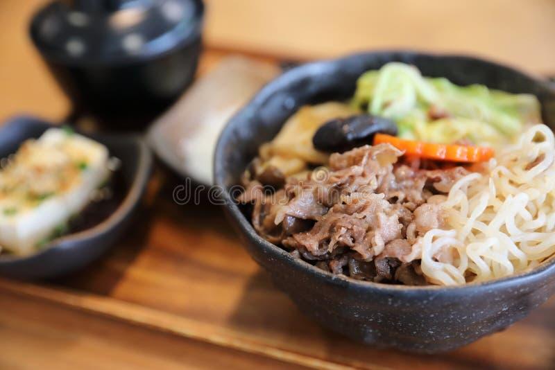 Sukiyaki donburi , sukiyaki hot pot stew with Japanese rice in bowl Japanese food. In closeup royalty free stock photography