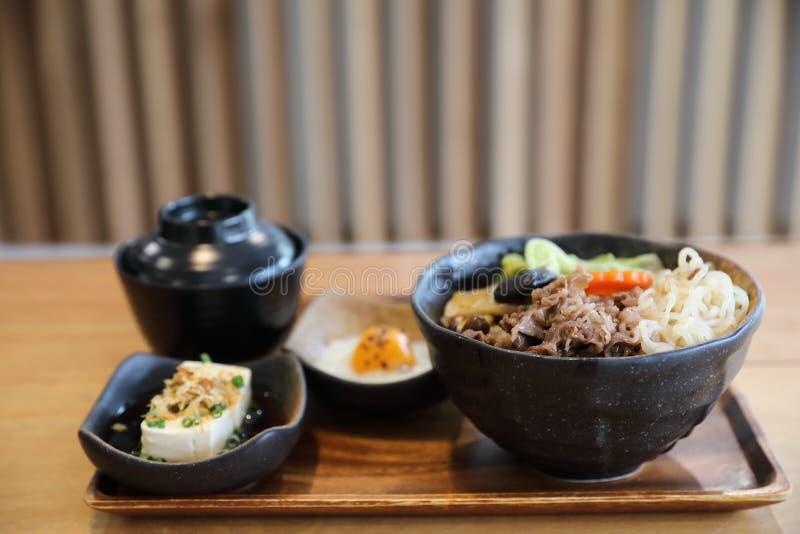 Sukiyaki donburi , sukiyaki hot pot stew with Japanese rice in bowl Japanese food. In closeup stock images