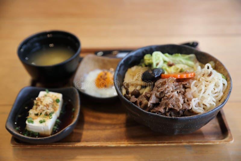 Sukiyaki donburi , sukiyaki hot pot stew with Japanese rice in bowl Japanese food. Sukiyaki donburi , sukiyaki hot pot stew with Japanese rice in bowl stock photo
