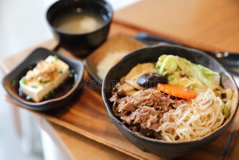 Sukiyaki donburi , sukiyaki hot pot stew with Japanese rice in bowl Japanese food. Sukiyaki donburi , sukiyaki hot pot stew with Japanese rice in bowl stock image