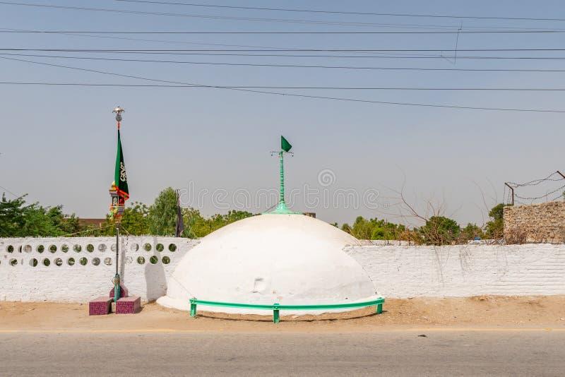 Sukkur Syed Sadar Ur Din Shah Tomb 46. Sukkur Hazrat Syed Sadar Ur Din Shah Tomb at Bukkur Island Picturesque View of a Cupola on a Sunny Blue Sky Day stock photos