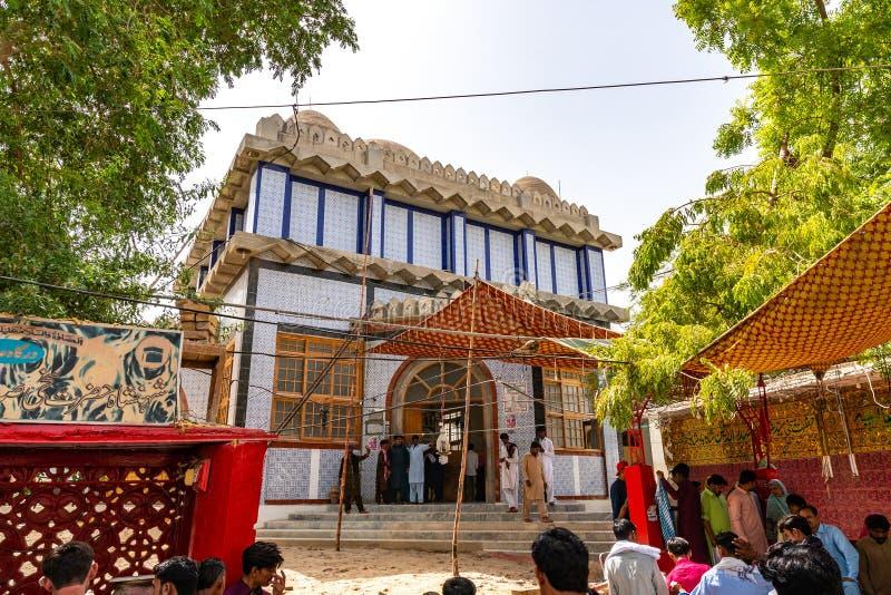 Sukkur Syed Sadar Ur Din Shah Tomb 48. Sukkur Hazrat Syed Sadar Ur Din Shah Tomb at Bukkur Island Picturesque View of Muslim Pilgrims Entering the Building stock photography