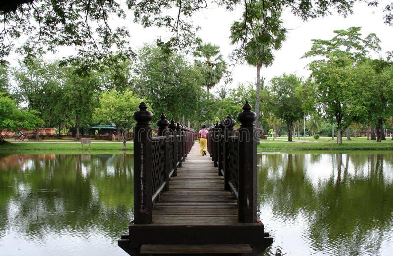 Sukothai jungle temple bridge thailand stock image