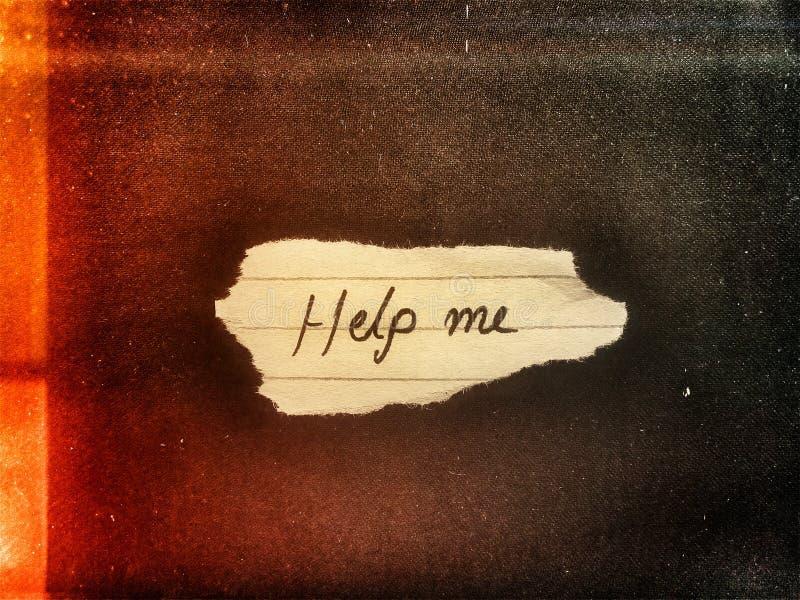 Sul piccolo pezzo di carta tagliata l'aiuto di parola me chiedere aiuto fotografie stock