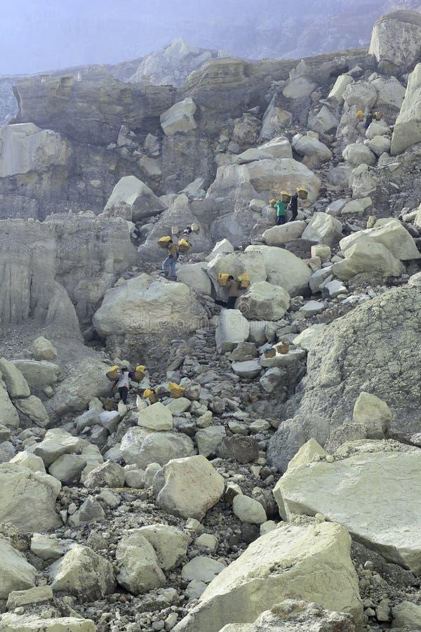 Free Sulfur Miners Working Hard Minimum Standard Stock Photo - 145527140