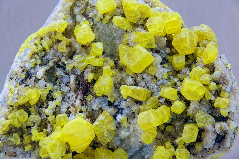 Sulfur Ore. The close-up of yellow Sulfur Ore royalty free stock images