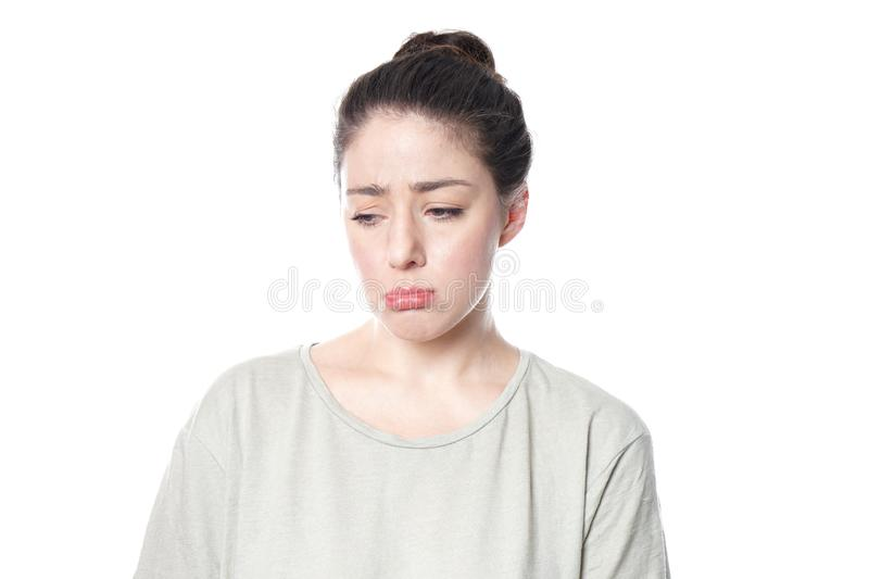Sulky pouting young woman acting childish stock images