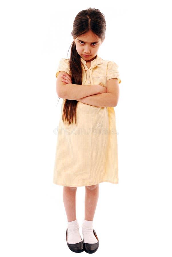 Sulking schoolgirl. Moody schoolgirl isolated on white stock photos