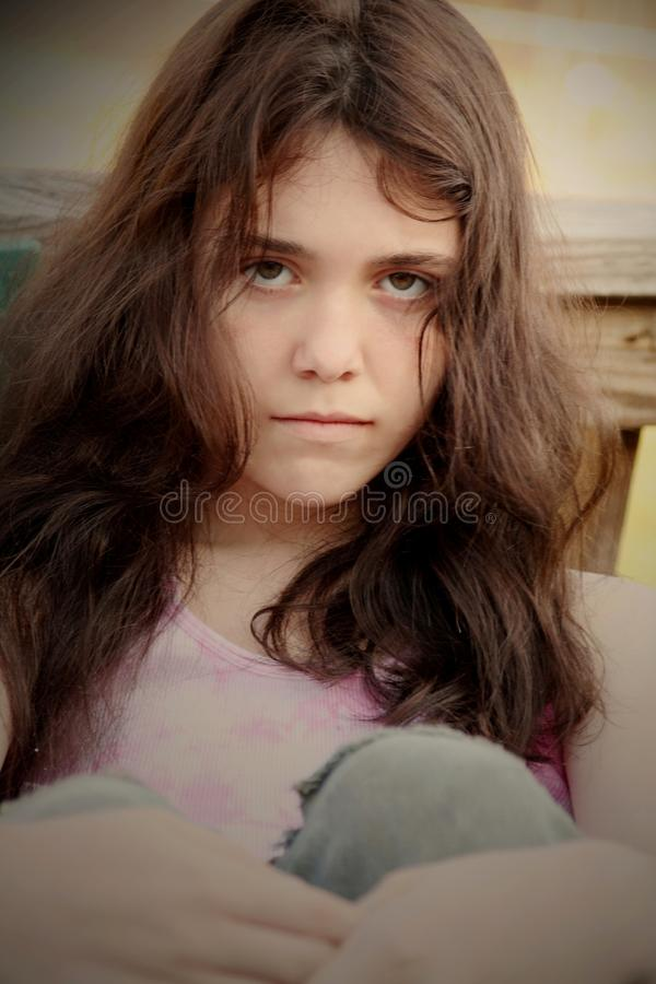 Sulky female teenager. Portrait of sulky female teenager with long hair stock photo