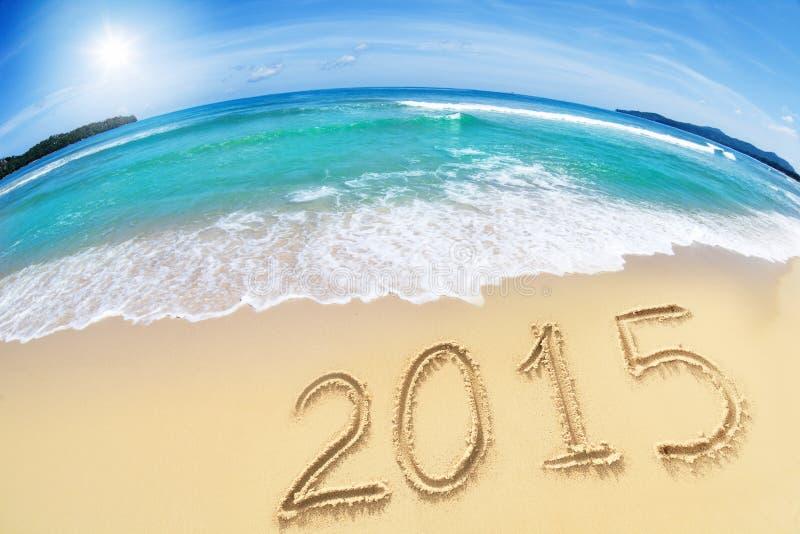 2015 sulla spiaggia di sabbia immagini stock