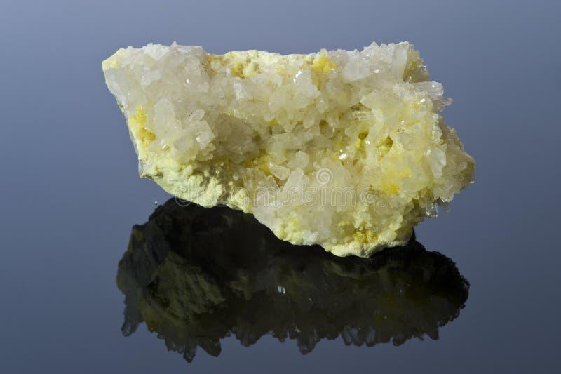 Sulphur and quartz crystals. stock image