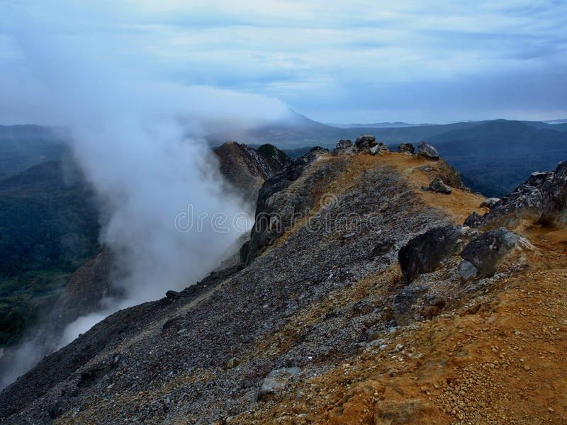 Sulphurous steam on a volcano Sibayak royalty free stock photo