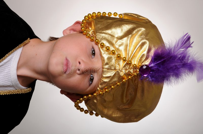 The Sultan. Young boy wearing a Sultan or Sheik's halloween costume royalty free stock images
