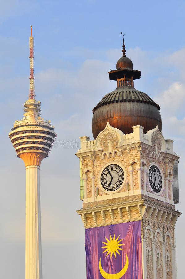 Sultan Abdul Samad building and the KL tower. The clock tower of the Sultan Abdul Samad Building in Kuala Lumpur Malaysia. At the backgrund, the KL Tower can be stock images