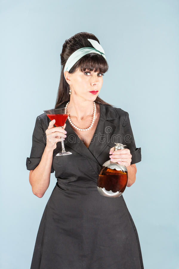 Sultry Retro Woman in Black Dress with Cosmopolitan stock image