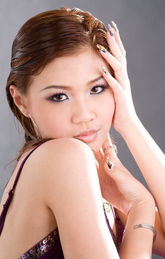Sultry vixen. Portrait of young woman posing sultryly royalty free stock photography