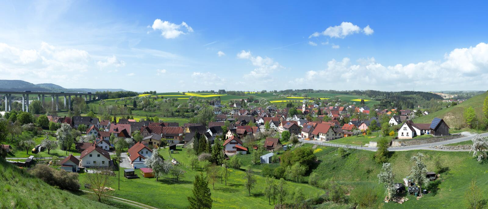 Sulz-Muehlheim, Germany in spring. Panorama of Sulz-Muehlheim in spring, on the left the motorway A81 with the Muehlbachtalbruecke, Baden-Wuerttemberg, Germany stock image