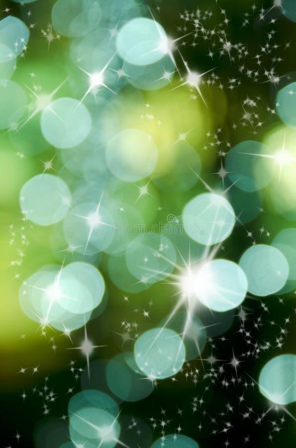 Sumário da estrela brilhante e da luz redonda verde foto de stock