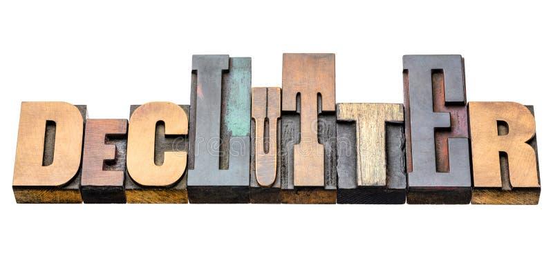 Sumário da palavra de Declutter no tipo de madeira foto de stock