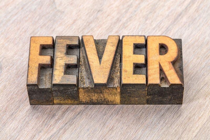 Sumário da palavra da febre no tipo de madeira fotos de stock royalty free