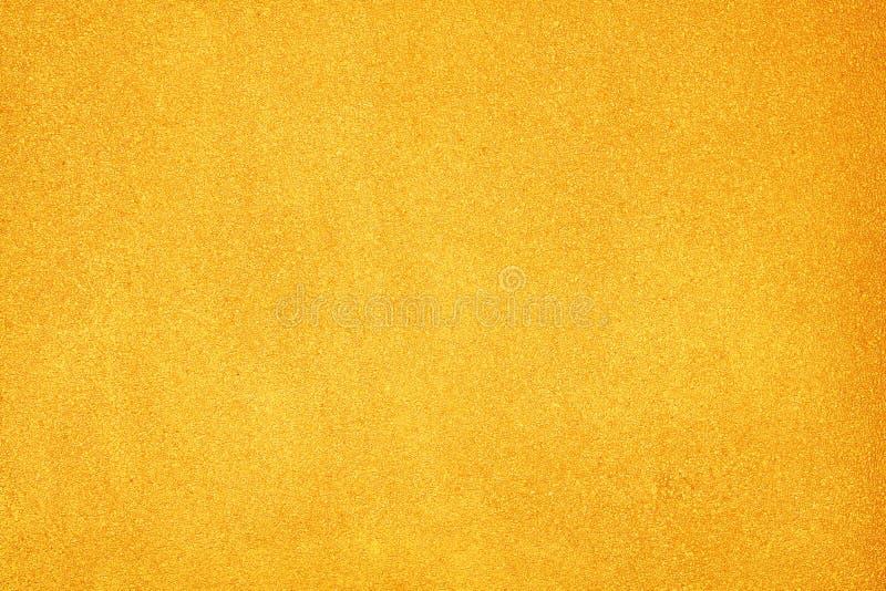 Sumário do muro de cimento do ouro, testes padrões ásperos coloridos da textura para o fundo fotografia de stock royalty free