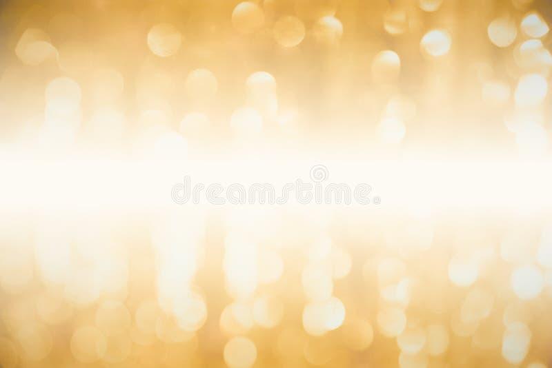 Sumário dourado luxuoso do bokeh do borrão para o fundo fotografia de stock royalty free