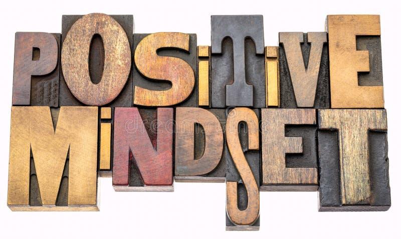 Sumário positivo da palavra do mindset no tipo de madeira foto de stock