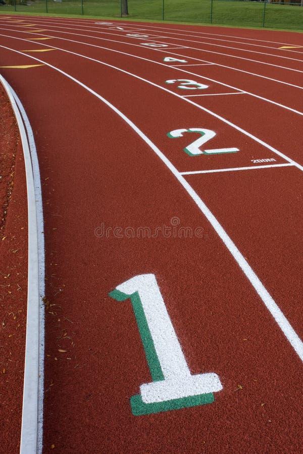 Sumário Running das trilhas com números da pista fotos de stock