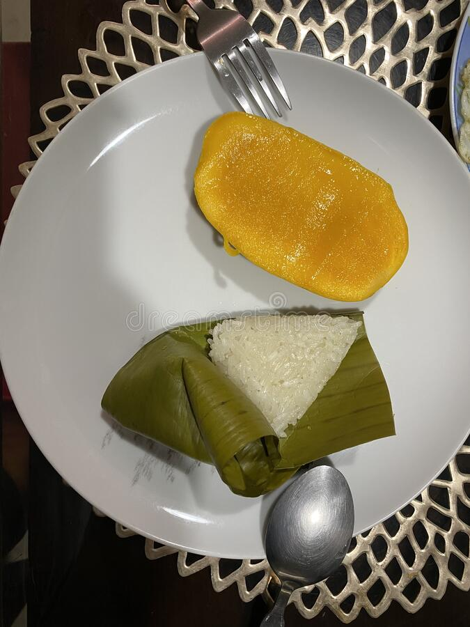 Suman or Filipino Rice Cake with Mango Slices stock image