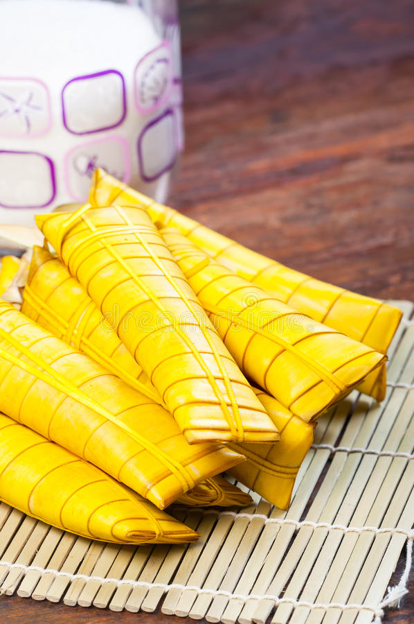 Suman. Rice cake wrapped in banana leaf aka suman, one of the traditional snacks in the philippines stock images