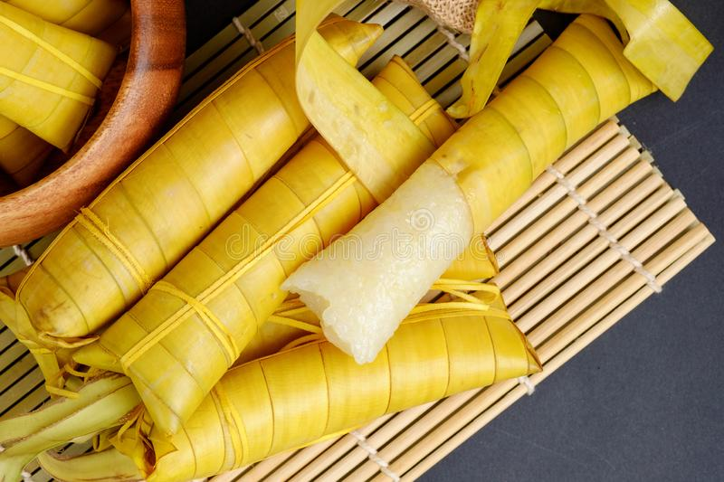 Suman sa Ibos. A traditional sticky rice cake wrapped in buli leaves royalty free stock images