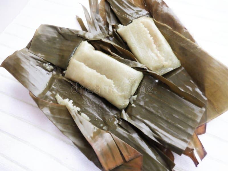 Suman sa lihiya Rice Cakes in Banana Leaves. Image of a suman sa lihiya, a filipino glutinous and sweet rice cakes in banana leaves stock photography